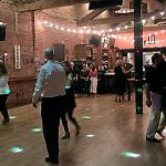 Couples dancing to the salsa music.