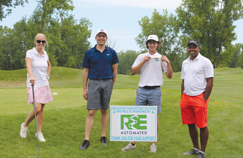 4 golfers pose during 1st Annual Charity Golf Outing